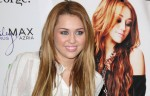 "Miley Cyrus CDs and DVD Signing and ""Miley and Max"" Clothing Line Launch at ASDA in Derby on November 9, 2010"