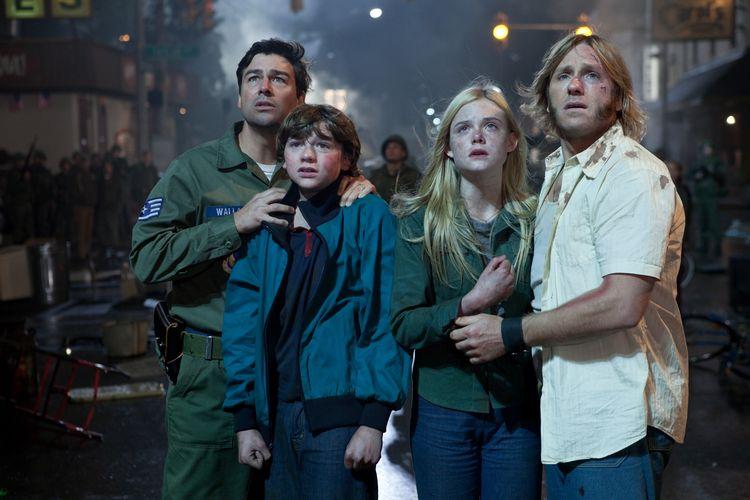 Left to right: Kyle Chandler plays Jackson Lamb, Joel Courtney plays Joe Lamb, Elle Fanning plays Alice Dainard, and Ron Eldard plays Louis Dainard