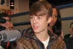 """2012 International Consumer Electronics Show - Day 3 - Justin Bieber Unveils the """"mRobo"""" Bass Portable Speaker & Dancing Robot at the TOSY Robotics Booth"""
