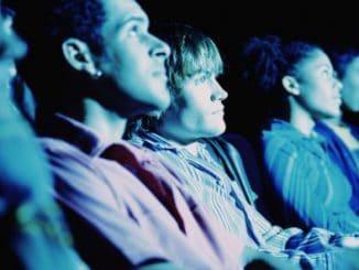 Group of teenagers watching movie
