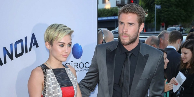 "Miley Cyrus and Liam Hemsworth - ""Paranoia"" Los Angeles Premiere - Arrivals"