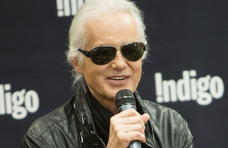 "Jimmy Page Stamps Copies Of His New Book ""Jimmy Page"""